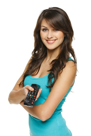 Happy woman holding TV remote control, over white background