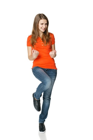 Full legnth of successful young female teenager in casual showing yes, isolated on white background