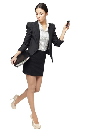 Full length of businesswoman hurring, isolated on white background
