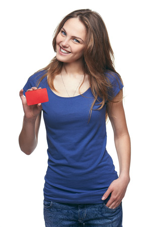 Photo pour Happy smiling girl in casual clothing, showing blank credit card, on white background - image libre de droit