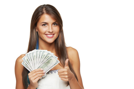 Photo pour Closeup of young beautiful woman with us dollar money in hand gesturing thumb up, over white background, with copy space - image libre de droit