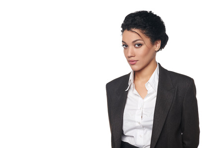 Portrait of african american business woman looking serious and confident, over white background
