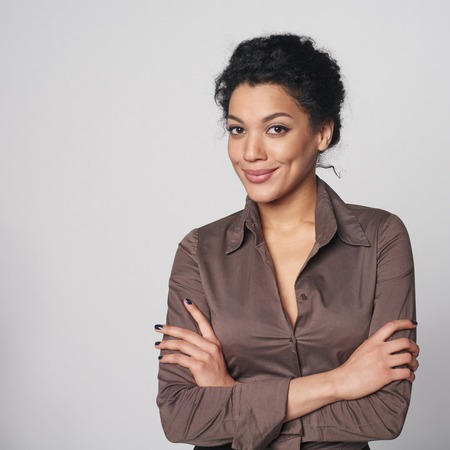 Portrait of smiling african american business woman looking confident and relaxedの写真素材