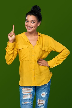 Hand counting - one finger. Happy mixed race african american - caucasian woman showing one finger, directing up, idea concept