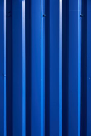 Photo pour Container pattern. Corrugated metal profiled panel. Metal rivets. Background of blue metal siding, corrugated iron sheet for exterior decoration - image libre de droit