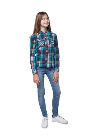 Photo pour Full length teen girl in checkered shirt standing casually over white background looking to side - image libre de droit