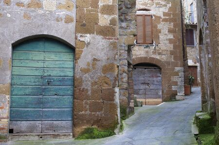 Alley with colorful wooden doors in Pitigliano