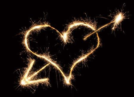 Photo pour heart and arrow sparkler - image libre de droit
