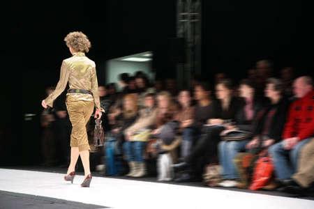 fashion model on podium from back