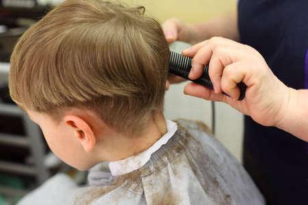 Boy cut in hairdressing salon