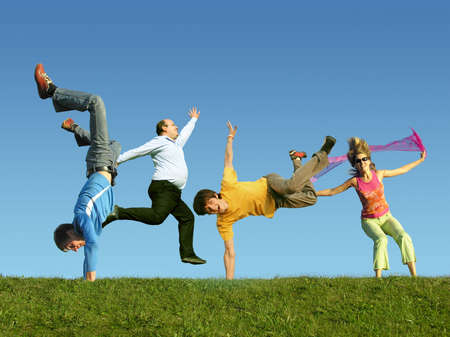 Photo pour Many jumping people on the grass, collage - image libre de droit