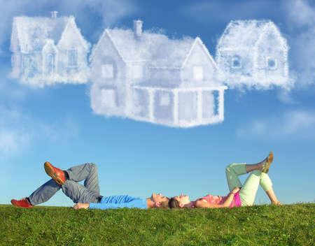 Foto de lying couple on grass and dream three cloud houses collage - Imagen libre de derechos