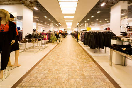 big shop of clothes, autumn clothes and collection of female bags