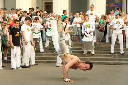 MOSCOW - MAY 15: Man dance on real capoeira performance at All-Russia Exhibition Center on May 15, 2010 in Moscow, Russia. Capoeira combines elements of martial arts, music, and dance