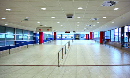 Walk with ladder grab in empty light hall inside airport at day