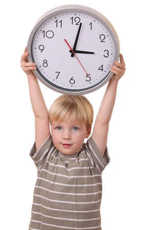 Portrait of a young boy holding a clock isolated on white background