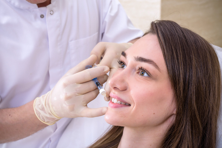 Photo pour Hardware cosmetology, mesotherapy, Close up of young woman getting treatment of cheek zone at spa. - image libre de droit