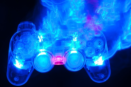 The blue game controller on a black background