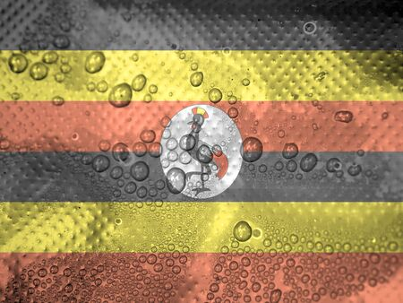 water drops on Uganda flag background