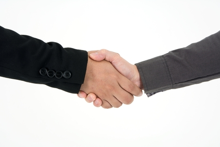 Photo pour Two businessman post to shake hand to commit deal and celebrate success isolated on white background - image libre de droit