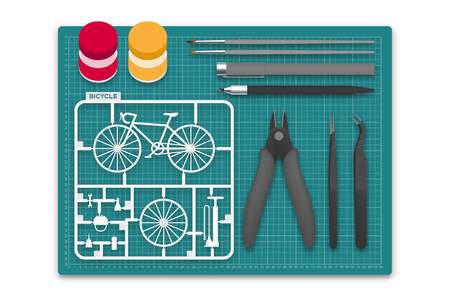 Ilustración de Plastic model with tool kit on cutting mat, bicycle concept design illustration isolated on white background with copy space - Imagen libre de derechos