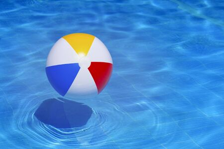 Photo pour Colorful inflatable ball floating in swimming pool, summer vacation concept - image libre de droit