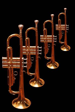 Photo pour Golden trumpets isolated on black background - image libre de droit