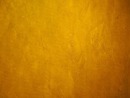 Foto de surface of the wall is rough, paint in gold texture material background - Imagen libre de derechos