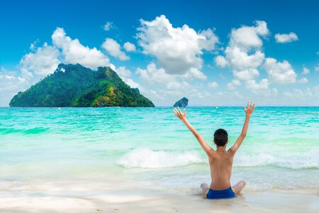 Photo for Happy young traveller enjoys in tropical beach. summer vacation on a tropical beach - Royalty Free Image