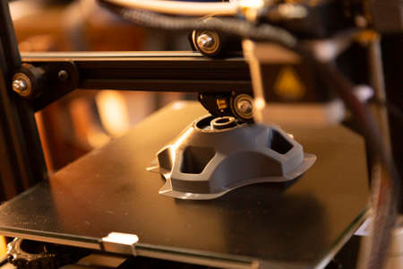 Photo for 3D printer prints a prototype piece. Selective Focus. - Royalty Free Image