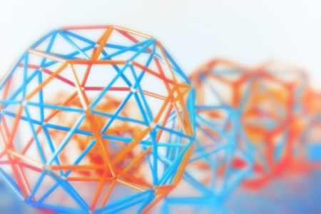 Foto de Coloured three-dimensional model of geometric solids closeup defocused - abstract blurred background. - Imagen libre de derechos