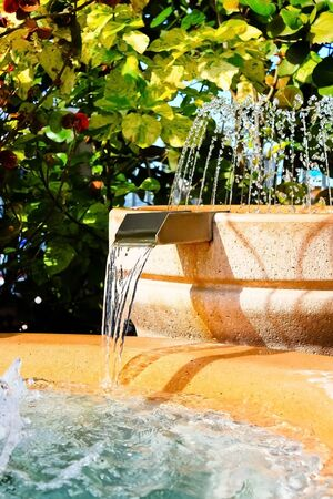 Tropical man made water fountain and waterfall