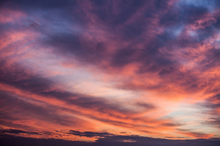 Abstract nature background. Dramatic and moody pink, purple and blue cloudy sunset sky