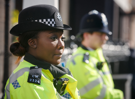 LONDON, UK - Apr 19, 2017: Metropolitan policewoman on duty at 10 St James's Square The Royal Institute of International AffairsChatham House
