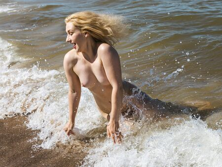 Photo for Lifestyle and beauty concept. Beautiful nude girl enjoying nature. Pretty young woman on the sea. Beautiful young naked woman on the seashore enjoying nature - Royalty Free Image
