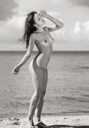 Photo for Beauty and nature concept. Young nude woman sunbathing on the beach - Royalty Free Image