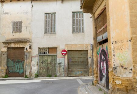 Nicosia, Cyprus - 18 February, 2016: Scenic streets and alleys in the Old Nicosia city centre. The old city of Nicosia within the Venetian Walls is a perfect place to walk in back alleys and abandoned areas, in search of derelict buildings with character