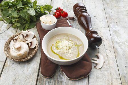Photo pour Mushroom cream soup on a wooden table. - image libre de droit