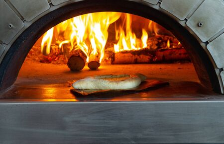 Photo pour A traditional cheese pie is taken out of the oven. - image libre de droit
