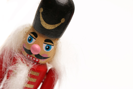 A wooden nutcracker isolated on a white background