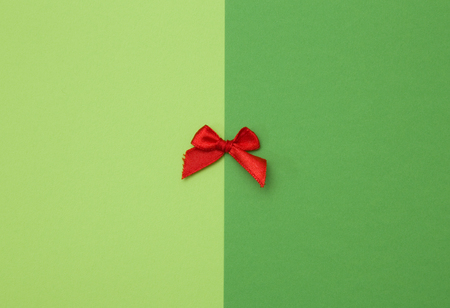 Tiny Red Bow on a Duel Colored Background