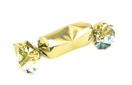 Gold Wrapped Candy on a White Background