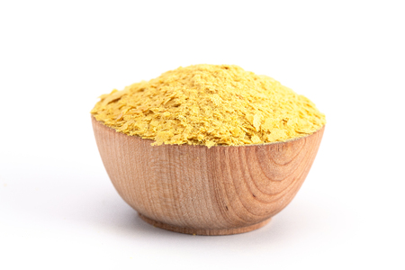Photo for Flakes of Yellow Nutritional Yeast a Cheese Substitute and Seasoning for Vegan Cooking - Royalty Free Image