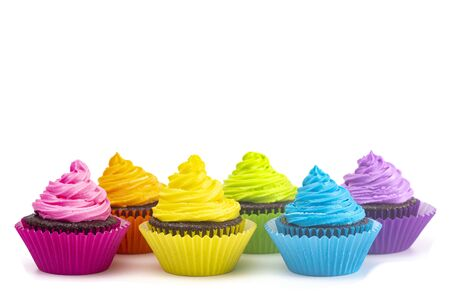 Photo for Rainbow Colored Frosted Chocolate Cupcakes Isolated on a White Background - Royalty Free Image