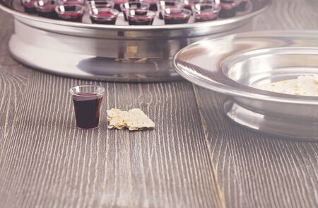 Photo for Table Set for Communion or the Lords Supper a Christian Remembrance of Jesus Death - Royalty Free Image