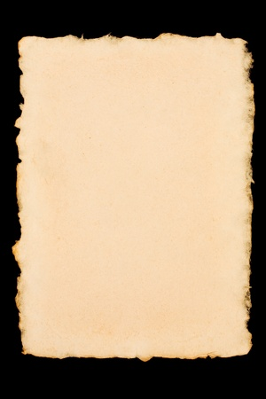 Old torn paper isolated on a black