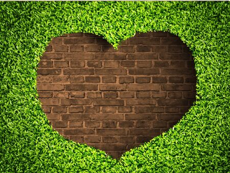 the heart of the grass on a brick background