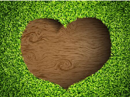 the heart of the grass on a wooden background