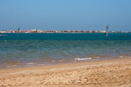 Windsurfing along sandy beach of Red Sea in Egypt