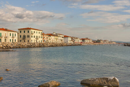 Marina di Pisa sunset view of the town waterfront. Tuscany, Italy.